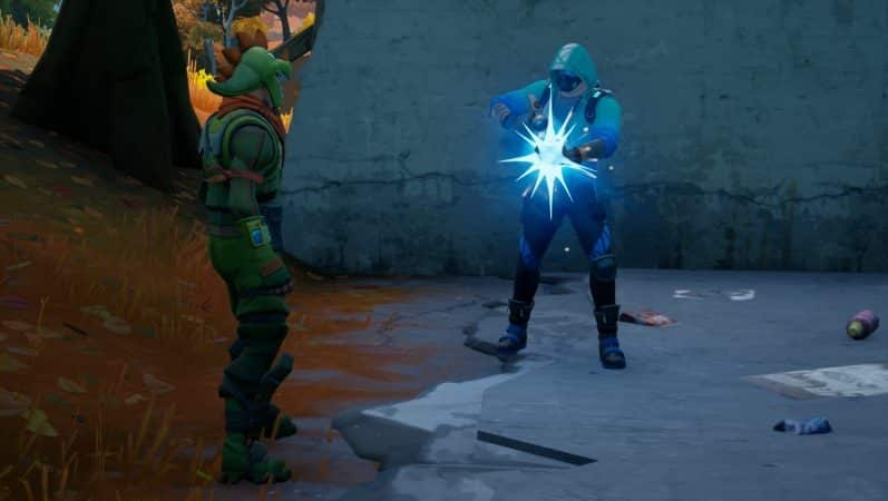 A screenshot showing a player holding a hammer surrouded by blue light, crafting an item